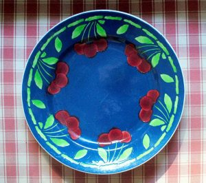 Blue plate with cherries